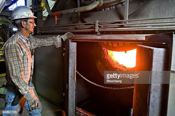 Olen Raisland a topblown rotary converter operator checks on concentrates in an electric furnace at Stillwater Mining Co's Columbus smelting plant in...