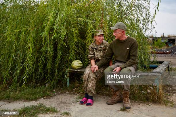Olena and Roman a married couple chat outside a bunker on the frontline on September 06 2017 in Avdiivka Ukraine Olena serves as a cook on a separate...