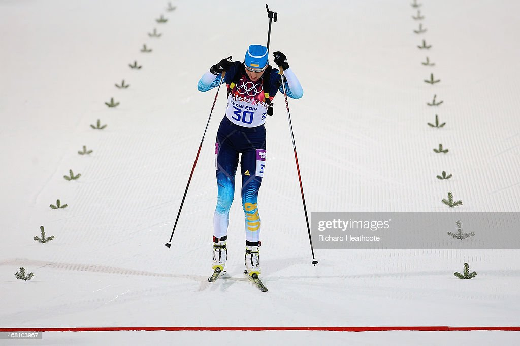 Olena Pidhrushna of Ukraine crosses the finish line in the Women's 7.5 km Sprint during day two of the Sochi 2014 Winter Olympics at Laura Cross-country Ski & Biathlon Center on February 9, 2014 in Sochi, Russia.