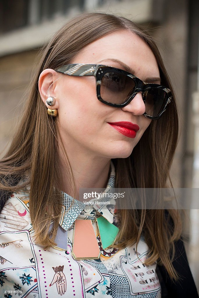 Olesya Oleynik wears Celine coat and sunglasses, & Other Stories shirt, and Dior earring before Alexis Mabille show on February 26, 2014 in Paris, France.
