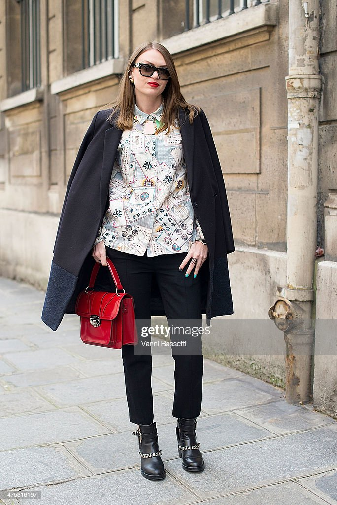 Olesya Oleynik wears Celine coat, trousers and sunglasses, & Other Stories shirt, Sandro shoes and Tosca Blu bag before Alexis Mabille show on February 26, 2014 in Paris, France.