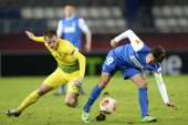 Olexandr Aliyev of FC Anji battles for the ball with Jelle Vossen of KRC Genk during the Europa League round 32 first leg match between FC Anji...