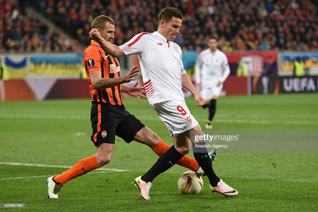Olexandr Kucher of Shakhtar Donetsk (L) competes for the ball with Kevin Gameiro (R) of Sevilla FC during the UEFA Europa League Semi-finals soccer match between Shakhtar Donetsk and Sevilla FC at Lviv Arena stadium on April 28, 2016, in Lviv, Ukraine.