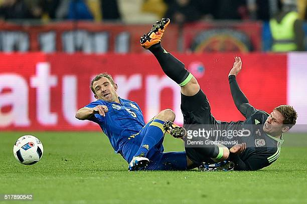 Olexandr Kucher of Ukraine and Simon Church of Wales battle for the ball during the International Friendly match between Ukraine and Wales at NSK...