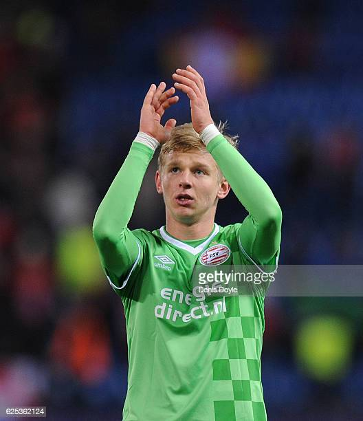 Olexandr Zinchenko of PSV Eindhoven applauds his team's fans at the end of the UEFA Champions League match between Club Atletico de Madrid and PSV...