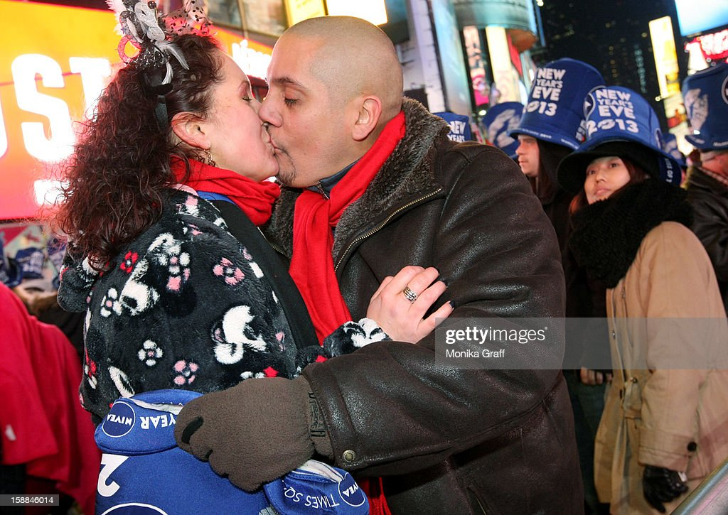 Olga and Michael Toerber of Chicago celebrate the new year as hundreds of thousands gather in Times Square on January 1, 2013 in New York City. Approximately one million people are expected to ring in the new year in Times Square.