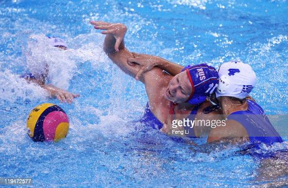Olga Belyaeva of Russia battles with Ilektra Psouni of Greece in the Women's Water Polo first preliminary round match between Greece and Russia...