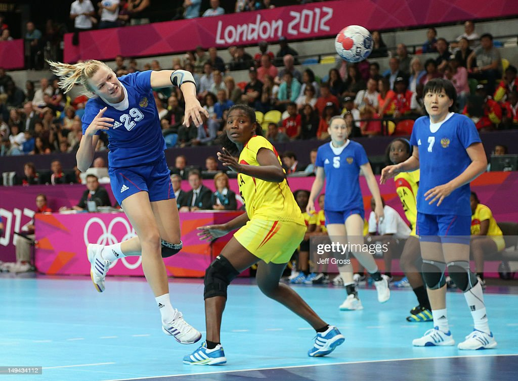 Olga Chernoivanenko of Russia shoots and scores a goal in the Women's Handball preliminaries Group A - Match 1 between Russia and Angola on Day 1 of the London 2012 Olympic Games at the Copper Box on July 28, 2012 in London, England.