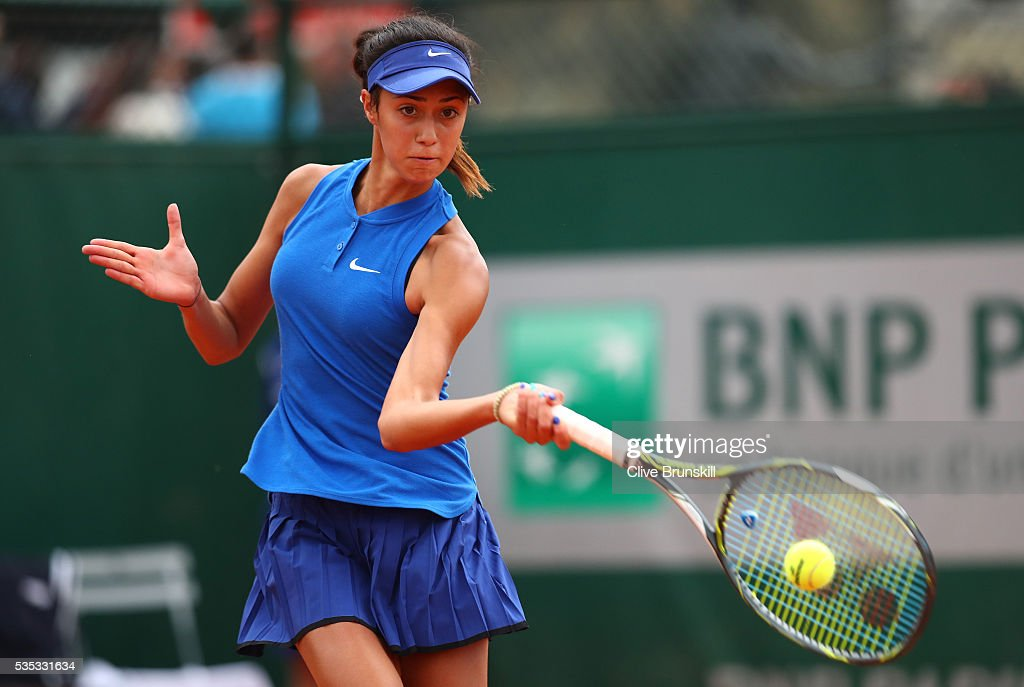 Olga Danilovic of Serbia hits a forehand during the Girls Singles first round match against Charlotte Robillard-Millette of Canada on day eight of the 2016 French Open at Roland Garros on May 29, 2016 in Paris, France.