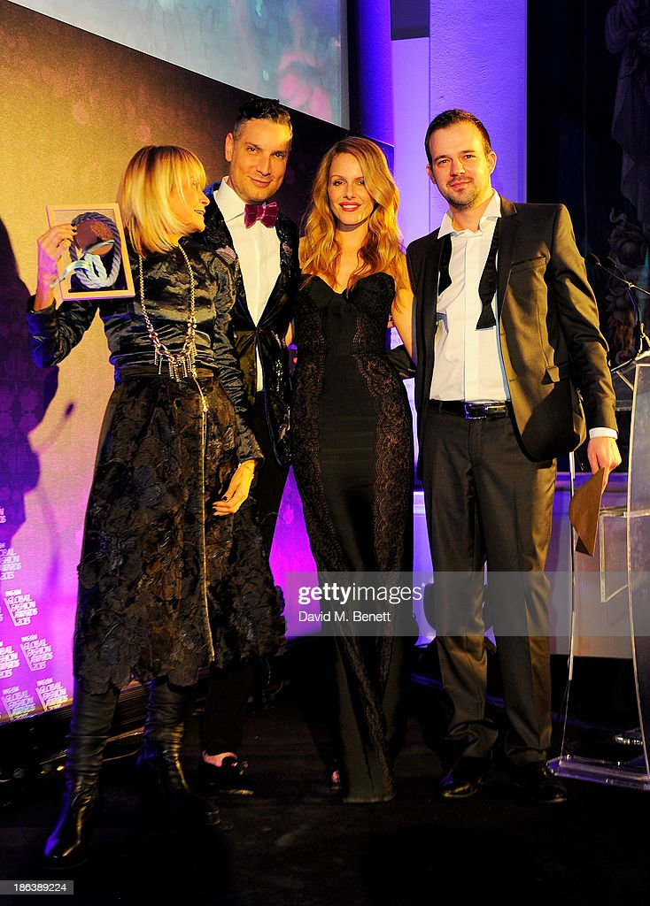 Olga Dobrovolskaya, Cameron Silver, Monet Mazur and Peter Isaev pose onstage at The WGSN Global Fashion Awards at the Victoria & Albert Museum on October 30, 2013 in London, England.