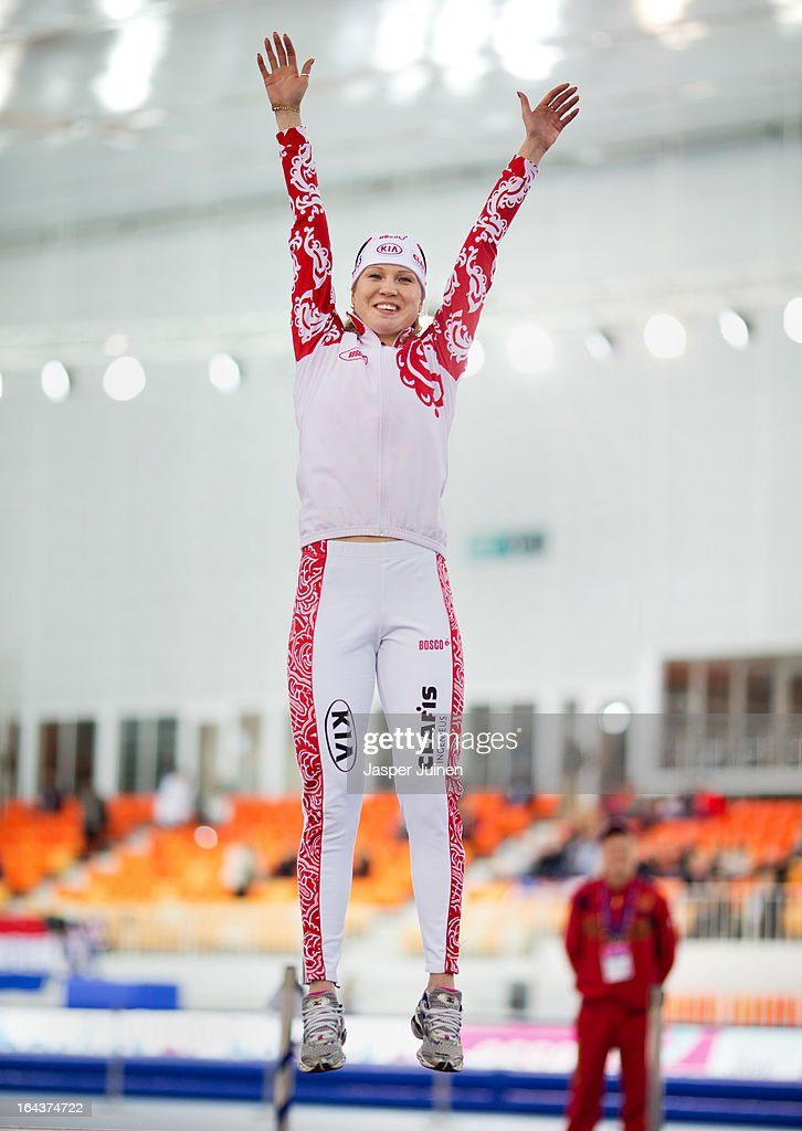 Olga Fatkulina of Russia celebrates on the podium after the 1000m race where she won gold on day three of the Essent ISU World Single Distances Speed Skating Championships at the Adler Arena Skating Center on March 23, 2013 in Sochi, Russia.