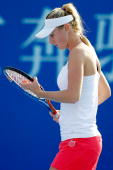Olga Govortsova of Belarus adjusts her racquet between points while playing Ana Ivanovic of Serbia during day five of the 2010 China Open at the...