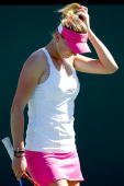 Olga Govortsova of Belarus adjusts her visor between points against Elena Dementieva of Russia during the BNP Paribas Open on March 12 2010 in Indian...