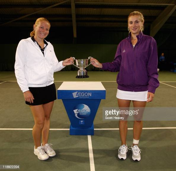 Olga Govortsova of Belarus and Alla Kudryavtseva of Russia hold the winners trophy after victory over Sara Errani and Roberta Vinci of Italy during...