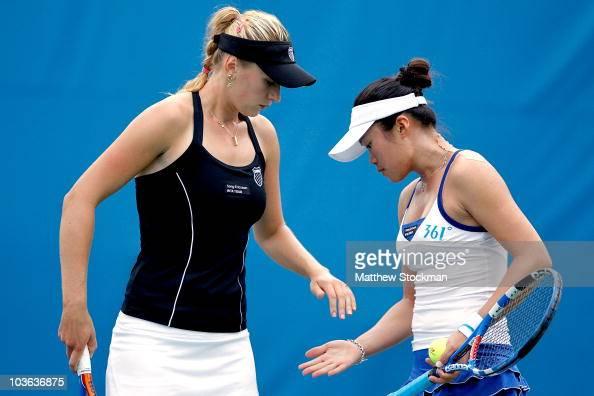 Olga Govortsova of Belarus celebrates a point with ChiaJung Chuang of Taipei while playing Yaroslava Shvedova of Kazakhstan and Vania King during the...