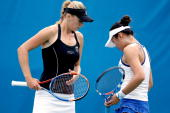 Olga Govortsova of Belarus confers with ChiaJung Chuang of Taipei while playing Yaroslava Shvedova of Kazakhstan and Vania King during the Pilot Pen...