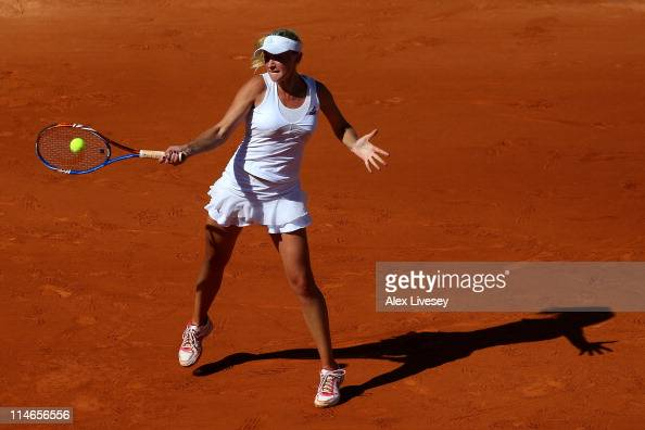 Olga Govortsova of Belarus hits a forehand during the women's singles round two match between Marion Bartoli of France and Olga Govortsova of Belarus...