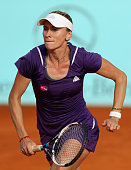 Olga Govortsova of Belarus in action against Misaki Doi of Japan in their match during day one of the Mutua Madrid Open tennis tournament at the Caja...