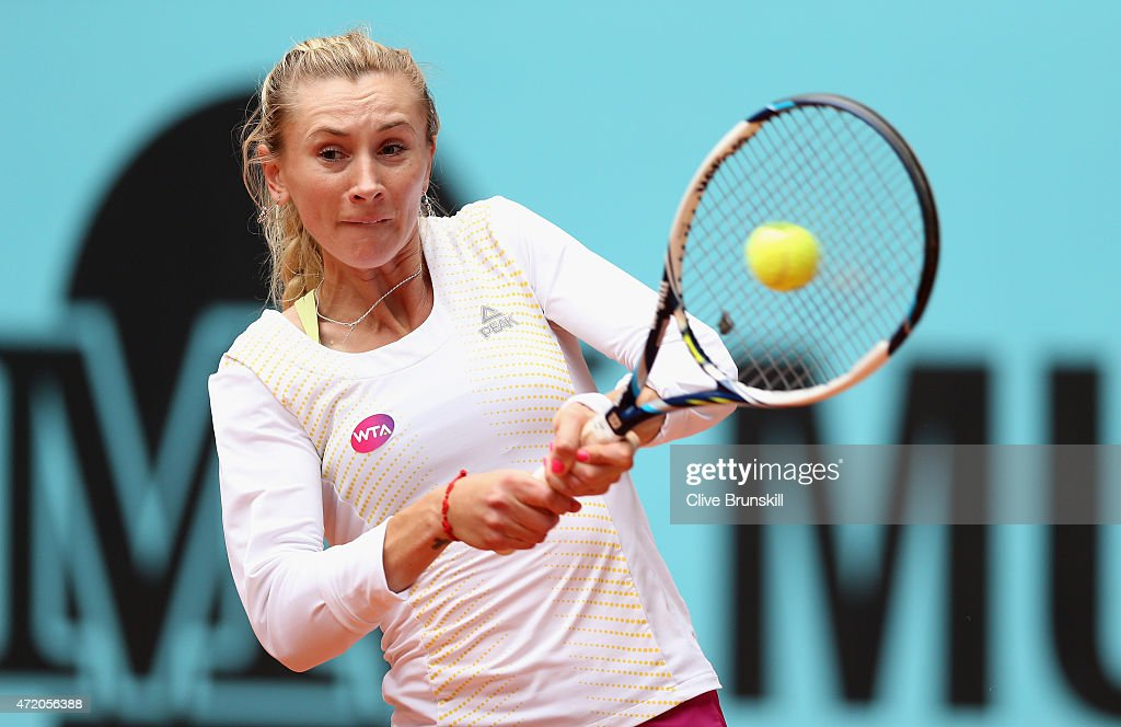 <a gi-track='captionPersonalityLinkClicked' href=/galleries/search?phrase=Olga+Govortsova&family=editorial&specificpeople=4325465 ng-click='$event.stopPropagation()'>Olga Govortsova</a> of Belarus plays a backhand against Petra Kvitova of the Czech Republic in their first round match during day two of the Mutua Madrid Open tennis tournament at the Caja Magica on May 3, 2015 in Madrid, Spain.