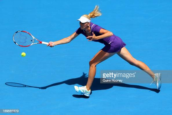Olga Govortsova of Belarus plays a forehand in her second round match against Na Li of China during day three of the 2013 Australian Open at...