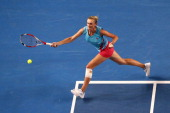 Olga Govortsova of Belarus plays a forehand in her second round match against Agnieszka Radwanska of Poland during day four of the 2014 Australian...