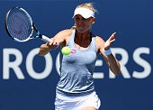 Olga Govortsova of Belarus plays a shot against Ana Ivanovic of Serbia during Day 3 of the Rogers Cup at the Aviva Centre on August 12 2015 in...