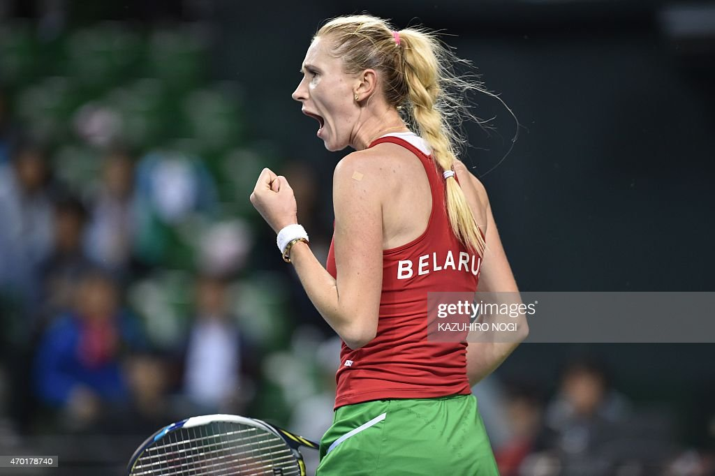 <a gi-track='captionPersonalityLinkClicked' href=/galleries/search?phrase=Olga+Govortsova&family=editorial&specificpeople=4325465 ng-click='$event.stopPropagation()'>Olga Govortsova</a> of Belarus reacts after a point against Japan's Kurumi Nara during their women's singles tennis match at the Fed Cup World Group II playoff in Tokyo on April 18, 2015.