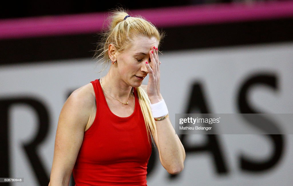 <a gi-track='captionPersonalityLinkClicked' href=/galleries/search?phrase=Olga+Govortsova&family=editorial&specificpeople=4325465 ng-click='$event.stopPropagation()'>Olga Govortsova</a> of Belarus reacts after loosing a point to Aleksandra Wozniak of Canada during their Fed Cup BNP Paribas match at Laval University in Quebec City on February 6, 2016 in Quebec City, Quebec, Canada.