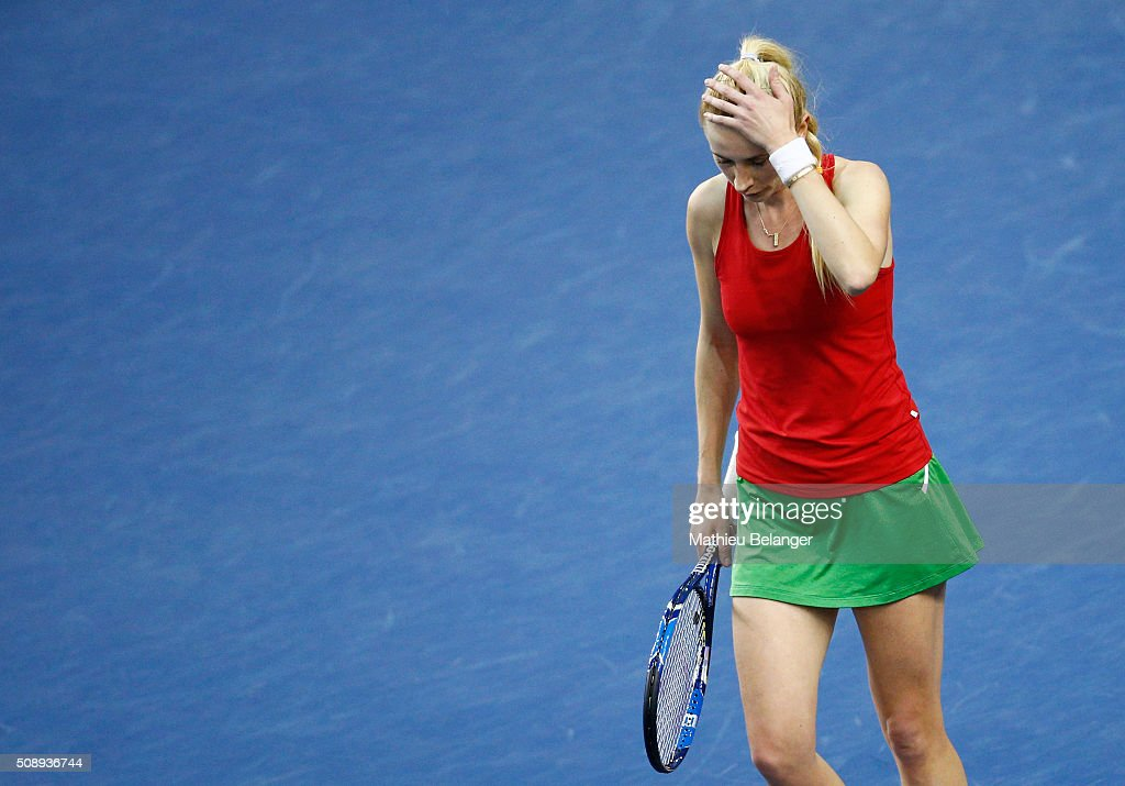 <a gi-track='captionPersonalityLinkClicked' href=/galleries/search?phrase=Olga+Govortsova&family=editorial&specificpeople=4325465 ng-click='$event.stopPropagation()'>Olga Govortsova</a> of Belarus reacts after loosing a point to Francoise Abanda of Canada during their Fed Cup BNP Paribas match at Laval University in Quebec City on February 7, 2016 in Quebec City, Quebec, Canada.