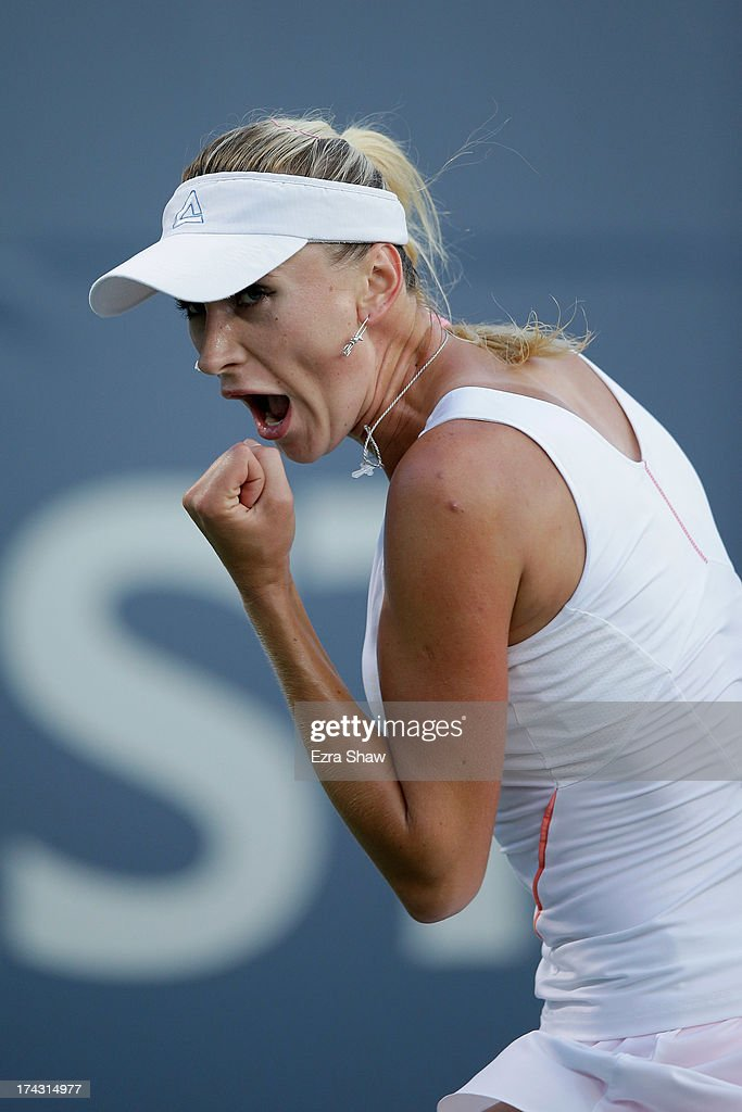 <a gi-track='captionPersonalityLinkClicked' href=/galleries/search?phrase=Olga+Govortsova&family=editorial&specificpeople=4325465 ng-click='$event.stopPropagation()'>Olga Govortsova</a> of Belarus reacts after winning a point during her match against Samantha Stosur of Australia on Day 2 of the Bank of the West Classic at Stanford University Taube Family Tennis Stadium on July 23, 2013 in Stanford, California.