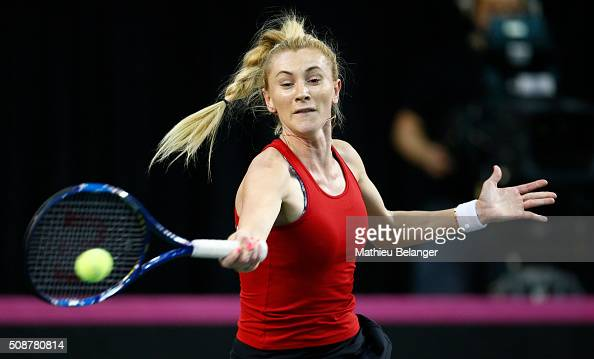 Olga Govortsova of Belarus returns a ball to Aleksandra Wozniak of Canada during their Fed Cup BNP Paribas match at Laval University in Quebec City...