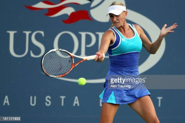 Olga Govortsova of Belarus returns a shot against Angelique Kerber of Germany during their women's singles third round match on Day Six of the 2012...
