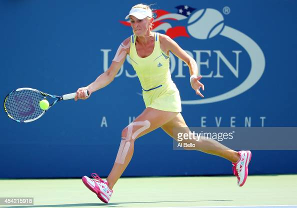 Olga Govortsova of Belarus returns a shot against Eugenie Bouchard of Canada during their women's singles first round match on Day Two of the 2014 US...