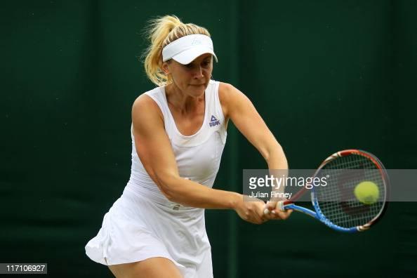 Olga Govortsova of Belarus returns a shot during her first round match against Agnieszka Radwanska of Poland on Day Three of the Wimbledon Lawn...