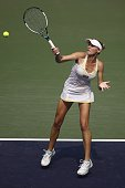 Olga Govortsova of Belarus returns a shot in her match against Alison Riske of the United States during day three of the WTA Tianjin Open at Tianjin...