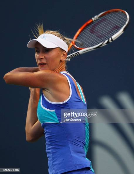 Olga Govortsova of Belarus returns a shot to Agnieszka Radwanska of Poland during the New Haven Open at Connecticut Tennis Center at Yale on August...