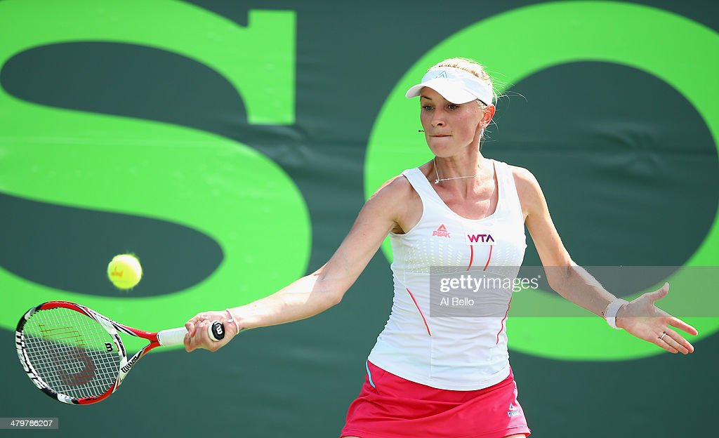 Olga Govortsova of Belarus returns a shot to Flavia Pennetta of Italy during their match on day 4 of the Sony Open at Crandon Park Tennis Center on March 20, 2014 in Key Biscayne, Florida.