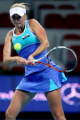 Olga Govortsova of Belarus returns a shot to Tamira Paszek of Austria during the China Open at the China National Tennis Center on September 29 2012...