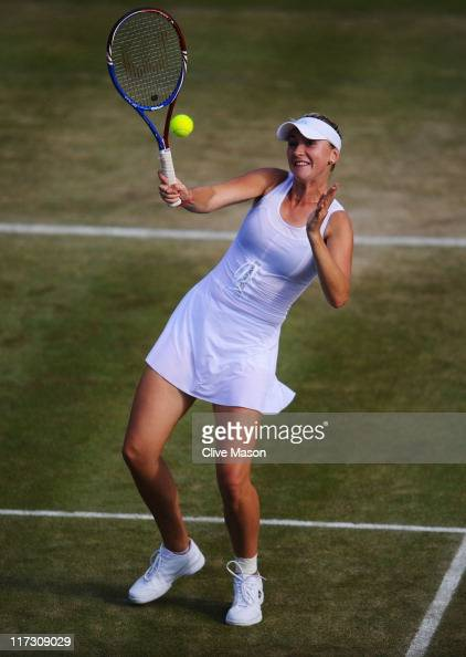 Olga Govortsova of Belarus returns a shot while playing with Eric Butorac of the United States during their first round double's match against Mike...
