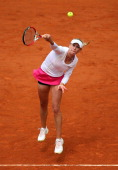 Olga Govortsova of Belarus serves in her Women's Singles match match against Marion Bartoli of France during day three of the French Open at Roland...