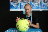 Olga Govortsova of Belarus signs autographs during day four of the Brisbane International at Pat Rafter Arena on January 2 2013 in Brisbane Australia