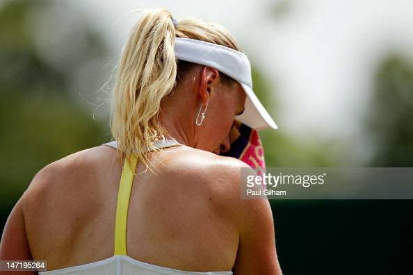 Olga Govortsova of Belarus takes a break during her Ladies' singles second round match against Annika Beck of Germany on day three of the Wimbledon...