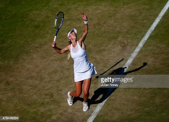 Olga Govortsova of Bulgaria serves in her Ladies' Singles third Round match against Magdalena Rybarikova of Slovakia during day six of the Wimbledon...