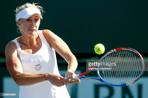 Olga Govortsova or Belarus returns a shot to Timea Bacsinszky of Switzerland during the BNP Paribas Open at the Indian Wells Tennis Garden on March 9...