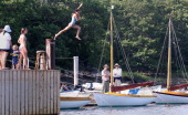 Olga Gregg from Maine dives of a dock at Hadley's Harbor on the Island of Naushon She was on the island visiting family