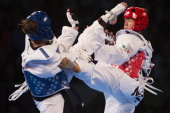 Olga Ivanova of Russia competes against Briseida Acosta of Mexico during the women's 73 kg final combat of WTF World Taekwondo Championships 2013 at...
