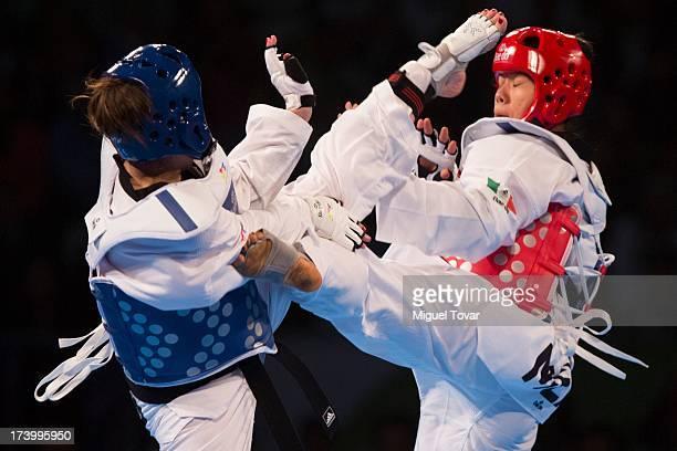 Olga Ivanova of Russia competes against Briseida Acosta of Mexico during the women's 73 kg final combat of WTF World Taekwondo Championships 2013 at...