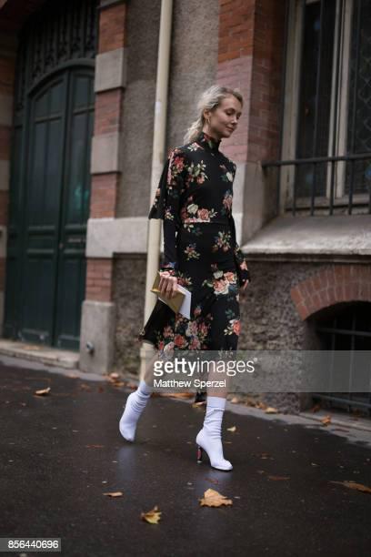 Olga Karput is seen attending Valentino during Paris Fashion Week wearing Valentino on October 1 2017 in Paris France