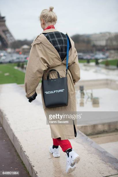 Olga Karput poses wearing Reebok shoes and OffWhite bag after the Hermes show at the Palais de Chaillot during Paris Fashion Week Womenswear FW 17/18...