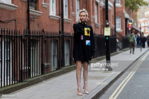 Olga Karput wearing sweater and transparent boots outside JW Anderson during London Fashion Week September 2017 on September 16 2017 in London England